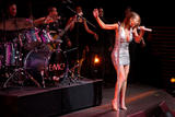 Mariah Carey performs on stage in small silver dress showing her legs and cleavage at Time Magazine 100 Most Influential People Event